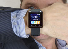 Man looking at his watch. Royalty Free Stock Image