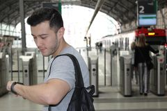 Man looking at his watch in the train station.  Royalty Free Stock Images
