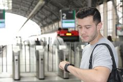 Man looking at his watch in the train station.  Royalty Free Stock Photo
