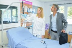 Man looking at hoist for bed. Hospital stock image