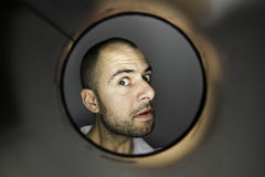 Man looking at a hole stock images