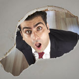 Man looking through a hole Stock Photography