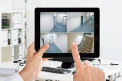Man Looking At Home Camera CCTV Videos Stock Images