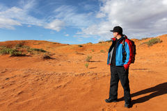 Man looking at the horizon. Man stops treking to admire coral pink sand dune state park Stock Photo