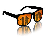 Man looking on hot dancing girls. Man's sun glasses with a reflection of hot dancing girls on a fire background Stock Photos