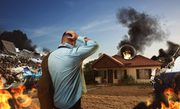 Man looking at the house after plane crash Royalty Free Stock Photos
