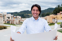 Man looking at a house project Stock Photos