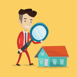 Man looking for house vector illustration. Young man using a magnifying glass for looking for a new house. Businessman with a magnifying glass checking a house Royalty Free Stock Photo