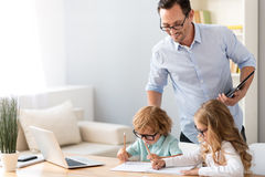 Man looking how children drawing Royalty Free Stock Photos
