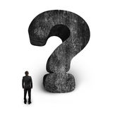 Man looking at huge 3D concrete question mark white background Stock Images