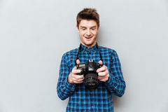 Man looking at images on camera and surprising royalty free stock image