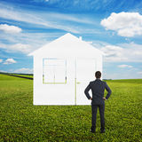 Man looking at imaginary house Royalty Free Stock Image