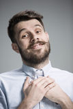 Man is looking imploring over gray background Royalty Free Stock Photo