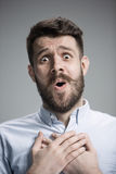 Man is looking imploring over gray background Stock Photography