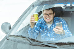 Man looking info in phone while sitting in car Royalty Free Stock Photos