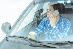 Man looking info in phone while sitting in car Royalty Free Stock Photo