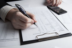 Man is looking for information in the in the budget figures Royalty Free Stock Images