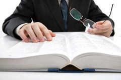 Man is looking for information in the dictionary. Close-up royalty free stock image