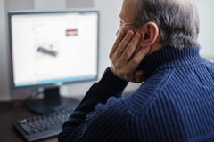 Man looking for information on the Internet. Retired develops co Stock Image