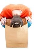 Man looking inside paper bag. Stock Photo
