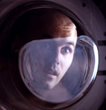 Man looking inside washing machine Royalty Free Stock Photography