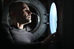 Man looking inside washing machine Royalty Free Stock Image