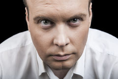 Man looking intently into the eyes Stock Photography