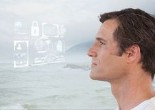 Man looking at interface over sea foam. Digital composite of Man looking at interface over sea foam Royalty Free Stock Photography