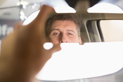 Man looking in an interior car mirror Royalty Free Stock Photos