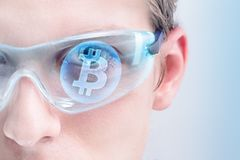 Bitcoin. Man looking into investing in Bitcoin or other cryptocurrencies Stock Images