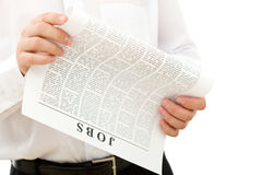 Man looking for job. Reading ads - isolated closeup royalty free stock photography