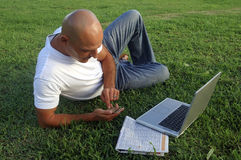 Man looking for job. Outside with laptop Stock Photo