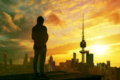 Man looking at kuwait city skyline. During sunset Royalty Free Stock Images