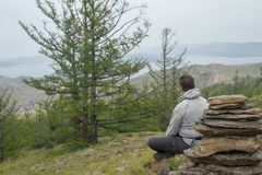 Man looking at lake Baikal from top of the hillock. Dedicated to a local Tutelary deity. Siberia, Russia royalty free stock photography
