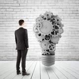 Man looking at lamp Stock Image