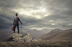 Man looking at the landscape. Travelling man wearing vintage clothes stock images