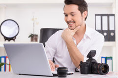 Man is looking at laptop with excitement. Stock Image