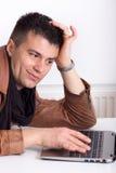 Man looking at laptop Stock Photography