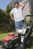 Man Looking At Lawn Mower Royalty Free Stock Photo