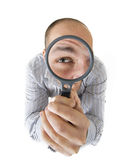 Man looking through the lens Stock Photography