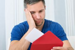 Man looking at letter Royalty Free Stock Photography