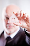 Man looking through a little transparent house Royalty Free Stock Image