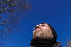 Man looking, low angle royalty free stock image