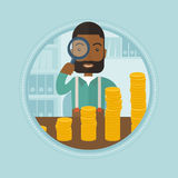 Man looking through magnifier at golden coins. An african businessman looking through magnifier at coins - business profit. Businessman satisfied by growth of Royalty Free Stock Photos