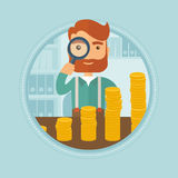 Man looking through magnifier at golden coins. Young caucasian hipster businessman with beard looking through magnifier at golden coins. Concept of profit and Royalty Free Stock Photos