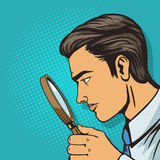 Man looking through magnifier pop art vector Royalty Free Stock Photos