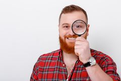 Man looking at magnifying glass Stock Photo