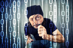 Man looking through magnifying glass Stock Photo