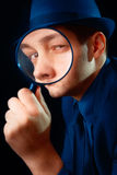 Man Looking through Magnifying Glass Royalty Free Stock Image