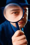 Man Looking through Magnifying Glass Royalty Free Stock Photography